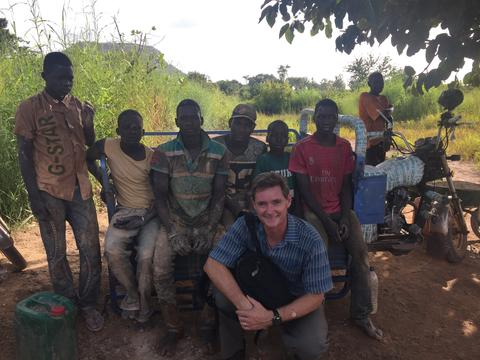 Philip with Children at the gold mine